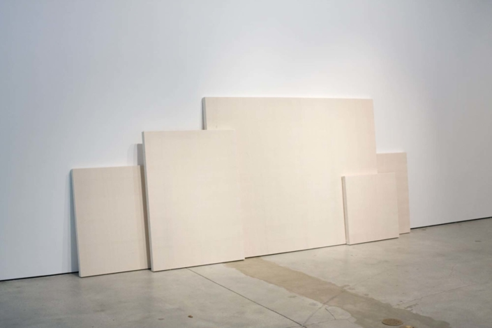 Frances Trombly, Leaning Canvases, 2010, Handwoven canvas, wood, 150 x 60 x 13 inches.