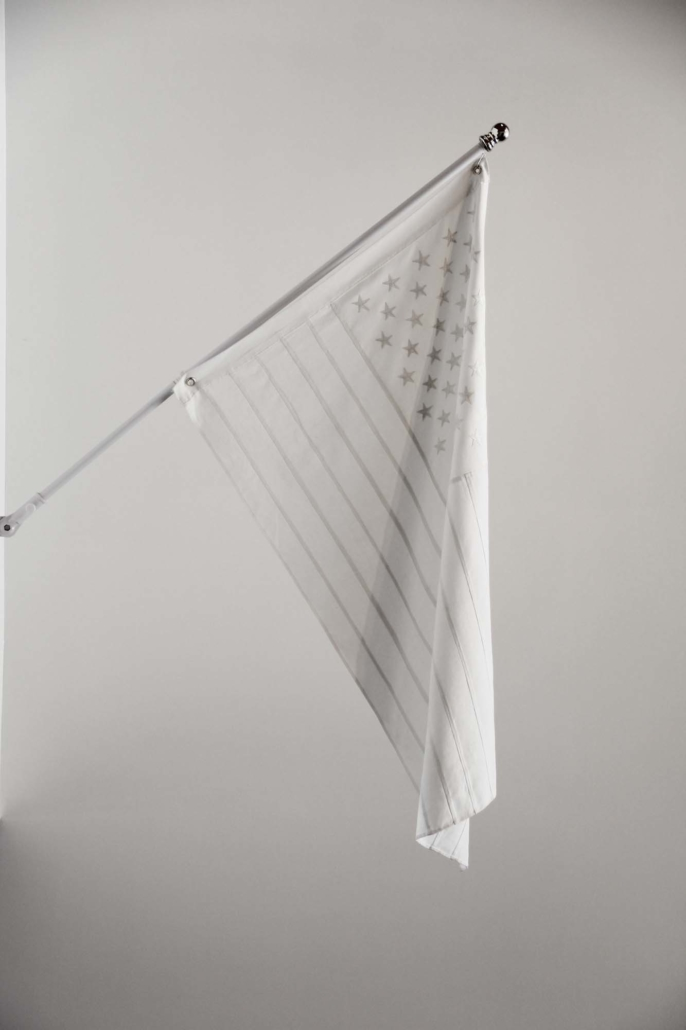 Frances Trombly, American Flag, 2012 Handwoven, embroidered and stitched, cotton, aluminum flag pole, 36 X 60 inches, Installation view, The Aldrich Contemporary Art Museum