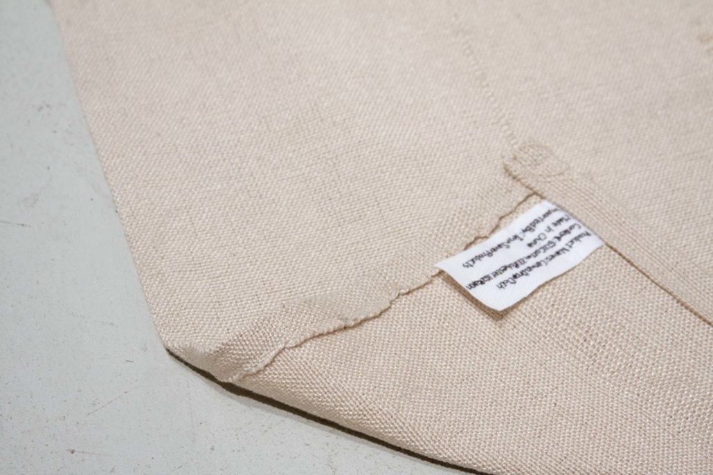 Frances Trombly, Canvas Drop Cloth, 2008. Handwoven cotton, embroidery, house paint, 63 x 119 inches