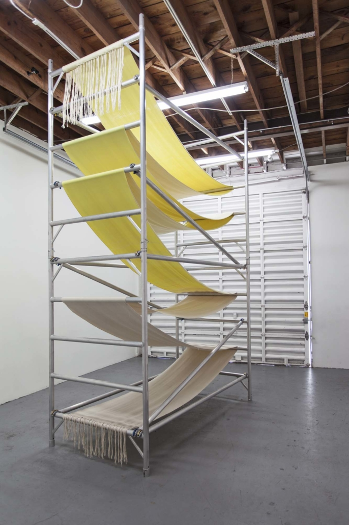 Frances Trombly, Over and Under, 2013, Handwoven cotton, handwoven rayon and cotton, aluminum scaffold, 162 x 72 x 48 inches. Installation view, Locust Projects, Miami, FL.