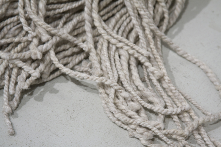 Frances Trombly, Mop, 2008, Handspun silver wool and cotton, wooden mop handle, 52 x 14 x 13 inches.